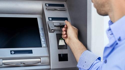 Melalui Mesin ATM